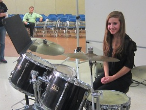 She looks good behind that drum set!