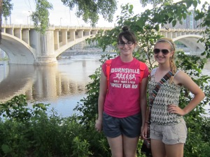 """Megan & Beccah with """"our"""" bridge in the background."""