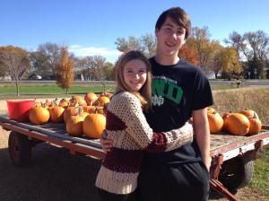 Megan & Jacob take a break from the pumpkin patch.