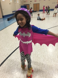 Batgirl's cape was flying around the gym.