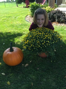 Back home showing off her pumpkin and the mum she picked for her mom.